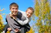 pic of rapture  - The happy child sits on the teenager shoulders - JPG