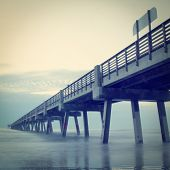 Jacksonville Beach, Florida fishing pier with retro effect.