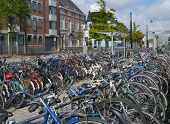 MAASTRICHT, NETHERLANDS - SEPTEMBER 8, 2013: Bicycle parking near the train station. The Maastricht