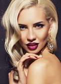portrait of beautiful woman with blond hair with jewelry