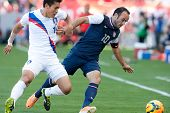 CARSON, CA. - FEB 01: Korea D Yong Lee #14 & USA M Landon Donovan #10 during the U.S. mens national