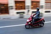 VALENCIA, SPAIN - JANUARY 28, 2014: A businessman on a scooter in the city center of Valencia. Due t