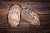 A discarded pair of worn out ballet shoes.Vintage, nostalgic effect suitable for Mother's day or Grandparents day.