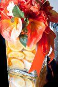 Closeup Of Wedding Centerpiece With Vase And Orange Slices