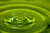 Extreme close-up image of drop. Drop of liquid; liquid splash.