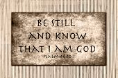 Be still and know that I am GOD. Psalm 46:10. Over a grunge background with bamboo in the far backgr