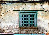 Old green window and grungy wall in Kathmandu, Nepal