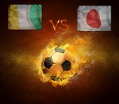 Hot soccer ball in fires flame, friendly game beetwin Cote d'Ivoire and Japan