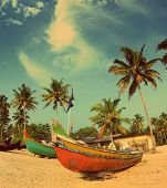 old fishing boats on indian beach - vintage retro style