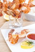 foto of tiger prawn  - Fresh fried Tiger Prawns on a spit - JPG