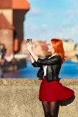 Fashionable Tourist Girl Taking Picture With Camera Old Town Gdansk