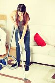 House work,young beautiful woman with vacuum cleanerat home. Housework concept