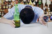 Drunk Man Sleeping In The Bar