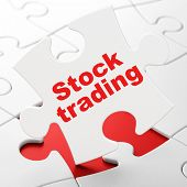 Finance concept: Stock Trading on puzzle background