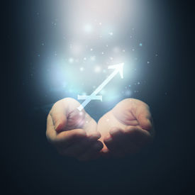 picture of sagittarius  - Female hands opening to light and holding zodiac sign for Sagittarius - JPG