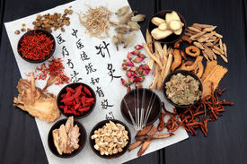 picture of chinese calligraphy  - Chinese herbal medicine selection with acupuncture needles and calligraphy script on rice paper - JPG