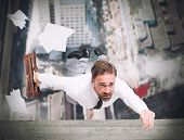 pic of skyscrapers  - Businessman is going to fall from a skyscraper - JPG