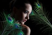 picture of female peacock  - Beautiful brunette young woman with peacock style make - JPG
