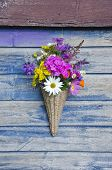 Beautiful  Flowers In Wicker Basket On Old Wooden Wall