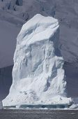 Iceberg As A Pillar On The Background Of The Glacier