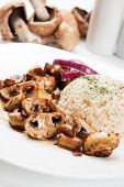 Grilled portabello mushrooms served with cooked rice
