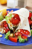 Vegetarian tortilla wraps with tomato, corn and lettuce