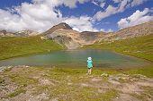 Hiker Enjoying An Alpine View