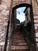 Narrow Stone Stairs In The Old Town Of Assisi, Italy
