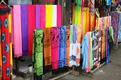 Rows Of Colourful Silk Scarfs Hanging At A Market Stall In Indonesia