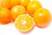 image of cleaving  - Oranges with plastic net on white background - JPG