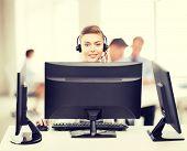 helpline operator with headphones in customer support center