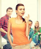 woman in blank t-shirt showing ok gesture at school