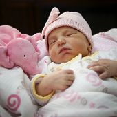 portrait of a sleeping newborn girl