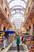 LIMA, PERU, MAY 25, 2014 - Senior tourist watches merchandise in commercial passage