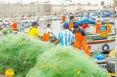 PISCO, PERU, MAY 21, 2014 - The picturesque fishermen's wharf of San Andres. Fishermen arrange their nets