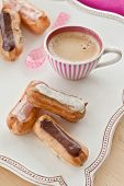picture of eclairs  - Hot coffee and a variety of little french eclairs - JPG
