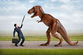 stock photo of underdog  - hostile business takeover concept businessman and tyrannosaurus - JPG