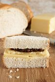pic of home-made bread  - Hand cut Cheddar cheese and pickle sandwich made with home made bread - JPG