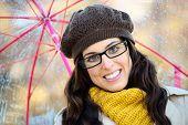 Woman With Glasses And Umbrella Under Autum Rain