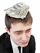 foto of dread head  - Portrait of upset stressed young businessman with money dollars on his head - JPG
