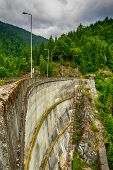 foto of hydro  - Small hydro electric dam harnessing water power in a mountain area - JPG
