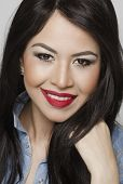 Portrait of pretty smiling young woman head shot photo