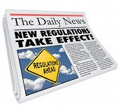 Постер, плакат: New Regulations Take Effect newspaper headline informing you of rules and laws impacting your life