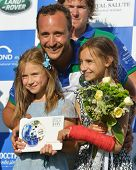 TSELEEVO, MOSCOW REGION, RUSSIA - JULY 26, 2014: Misha Rodzianko with children holding the winner's prize during the British Polo Day. Tseleevo Golf & Polo Club hosts the event for the second time