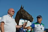 TSELEEVO, MOSCOW REGION, RUSSIA - JULY 26, 2014: Alexis Rodzianko (right) holds the best polo pony during the British Polo Day. Tseleevo Golf & Polo Club hosts the event for the second time