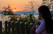 pic of chan  - Young woman standing on the hill watching the sunset over the lake in Kaeng Kra Chan National Park Phetchaburi Province Thailand - JPG