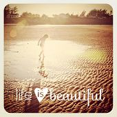 Girl playing in water at beach with quote- With Instagram effect