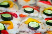 Fillet Of Fish Roasted And Decorated With Vegetables.