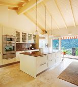 stock photo of attic  - Modern kitchen in the attic - JPG