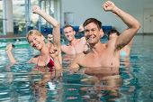 picture of day care center  - Fitness class doing aqua aerobics in swimming pool at the leisure centre - JPG